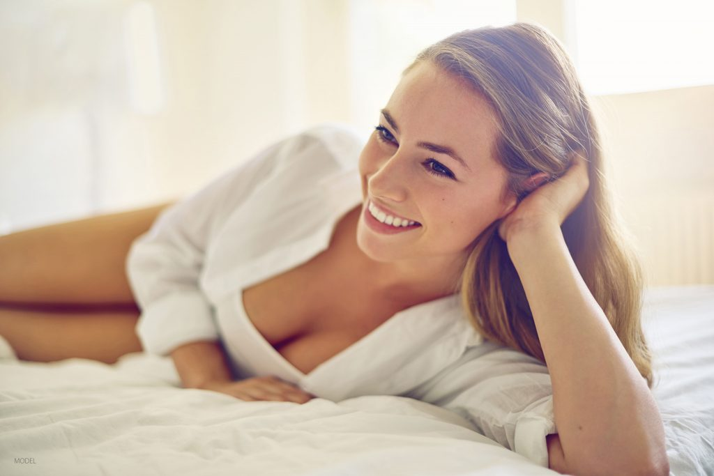 Woman is happy with her breast augmentation results.