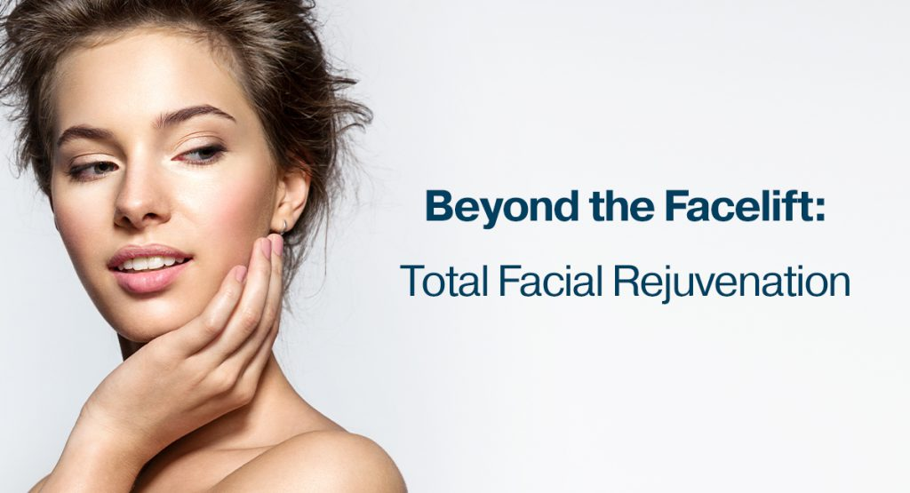 Woman touching her face after recovering from a face lift in Los Angeles, CA